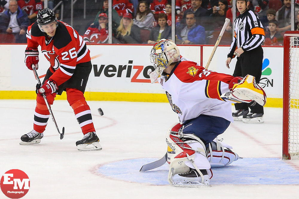 Mar 31, 2014; Newark, NJ, USA; New Jersey Devils left wing Patrik Elias (26) shoots the puck at Florida Panthers goalie Dan Ellis (39) during the first period at Prudential Center.