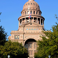 Texas State Capitol Building in Austin, Texas<br /> In 1888, the builders of the Texas State Capitol accepted three million acres of land stretching 200 miles along the New Mexico border in lieu of $3 million dollars. Also adhering to the slogan, &ldquo;Everything&rsquo;s Bigger in Texas,&rdquo; this grand building is the nation&rsquo;s largest capitol. The Italian Renaissance structure has almost 900 windows, 400 rooms and 360,000 square feet of space. The Sunset Red Granite fa&ccedil;ade gives it a unique and beautiful glow. Texas became the 28th state on December 29, 1845.