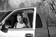 handsome man seated in a truck