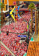 Thousands gather along Freemont Street for the start of the The Las Vegas Great Santa Run .