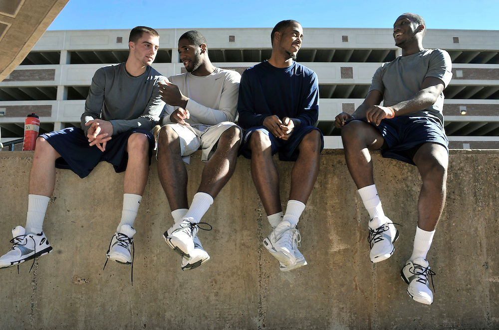 Connecticut basketball players, from left, Kyle Bailey,, Alex Oriakhi, Jamal Coombs-McDaniel and Donnell Beverly wait to be interviewed after the Husky Run in Storrs, Conn., Wednesday, Oct. 13, 2010.   (AP Photo/Jessica Hill)