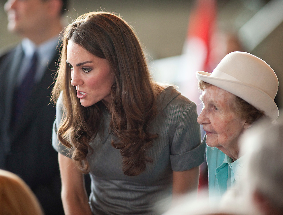 Catherine the Duchess of Cambridge speaks to World War 2 war brides during a tour the War Museum in Ottawa, Canada, July 2, 2011,  the third day of their nine day tour of Canada.<br /> AFP PHOTO/GEOFF ROBINS