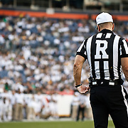 SHOT 9/19/15 5:28:02 PM - A college football referee during a break in the action in the Rocky Mountain Showdown featuring Colorado versus Colorado State at Sports Authority Field at Mile High in Denver, Co. Colorado won the game 27-24 in overtime. (Photo by Marc Piscotty / © 2015)
