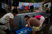 Doing laundry at a new washing center at Rakovica resettlement camp for Roma displaced from Gazela.