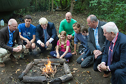 Shooters Hill, London, uly 30th 2015. Mayor of London Boris Johnson celebrates 100,000 Team London volunteers in his project to mobilise an army of volunteers across the capital to undertake youth projects aimed at reducing crime. The Wide Horizon project icorporates volunteers from thius undertaking and the Mayor was shown first hand how the project has enabled the Wide Horizon's Adventure Training centre to add another facility to engage and educate children and youths. PICTURED: The Mayor of London Boris Johnson poses with people behind the Wide Horizons project