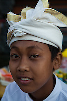 Wearing traditional clothing and hats is the rule rather than the exception in Bali.  This is especially true at festivals and temple visits when wearing sarong is a must to enter. Children also put on traditional garb and help out with festival preparations.