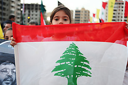 Supporters of the Shiite resistance and political group, Hizballah, rallied in the Dahiyeh southern suburbs of Beirut to watch a televised speech from Hizballah General Secretary Hassan Nasrallah. The rally was called for by Hizballah to celebrate Land Day, which is the 9th anniversary of Israel's withdrawal from southern Lebanon, which Hizballah and its supporters say was a victory over Israel. The rally comes just 13 days before Lebanese go to the polls to elect a new parliament. With Sunni Muslims and Shia Muslims mostly supporting their respective sectarian parties, Nasrallah praised Christian leader Michel Aoun. Aoun is head of the Free Patriotic Movement, which is allied with the Hizballah-led opposition March 8 coalition. ///A young girl holds a Lebanese flag.