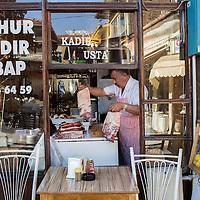 A kebab usta (master) prepares lamb ribs and lamb leg for roasting in Corum, in north-central Anatolia.