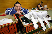 "ASASHORYU - SUMO wrestler with the highest rank of ""YOKOZUNA"", in a changing room of the TOKYO kyokai (sumo stadium), before the retirement ceremony of the wrestler Toki, in front of the ceremonial ropes uniform that he was to wear for the ceremony.  Tokyo 27 January 2007"