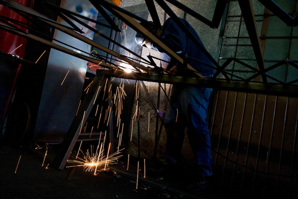 Fidel Soto welds a door in Nogales, Sonora, Mexico, on Thursday, Jan. 31, 2008. Nogales and the surrounding desert is one of the main points of illegal crossings into the United States.