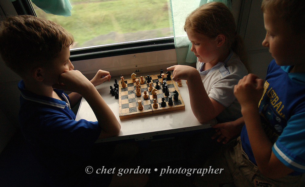 Russian children playing chess in the Third Class railway car of a Moscow-to-Tomsk bound Trans Siberian Railway route outside Omsk, Siberia Russian Federation on June 11, 2005.