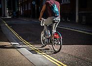 Cyclist riding a Santander Hire Bicycle through London, Britain 25 Sep 2016