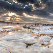 Sunbeams shine down on chunks of ice at Brewster's Paine's Creek Beach.