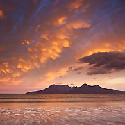The Isle of Rum, as seen from the Isle of Eigg, Scottish highlands, Scotland.