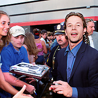 "Mark Wahlberg signs autographs outside the Danver's MA. Loews Theatre as he arrives for the local premier of the movie he stars in ""The Perfect Storm"" June28'00."