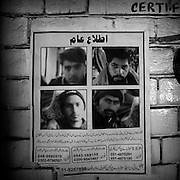 Peshawar. Wanted persons on the poster that is hang up on a bus station.