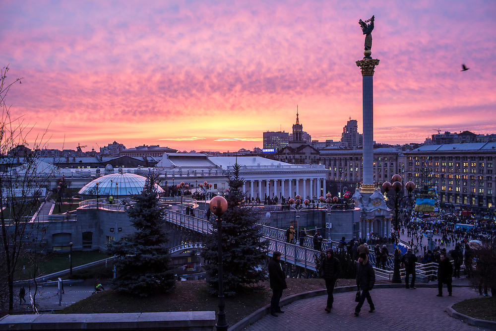 KIEV, UKRAINE - DECEMBER 4: The sun sets over Independence Square on December 4, 2013 in Kiev, Ukraine. Thousands of people have been protesting against the government since a decision by Ukrainian president Viktor Yanukovych to suspend a trade and partnership agreement with the European Union in favor of incentives from Russia. (Photo by Brendan Hoffman/Getty Images) *** Local Caption ***