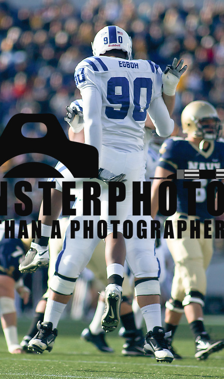 Duke Senior (#90) Patrick Egboh and Senior Center (#62) Bryan Morgan celebrate after Egboh sacks Navy Senior QB (#4) Ricky Dobbs early in the first quarter for eight yards.  Duke defeats Navy 34-31 at Navy-Marine Corps Memorial Stadium in Annapolis Maryland.