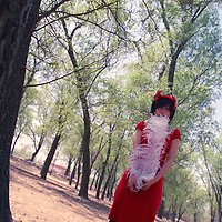 BEIJING, 24 APRIL 2006: Tian Yuan in the forest.<br /> Tian Yuan is China&rsquo;s latest newcomer in  arts &amp; entertainment . The 21 -year- old came  to fame at the age of 16, when she wrote her first book &ldquo; Zebre dans la foret&rdquo;which was highly acclaimed in France . Tian is a representative of a &ldquo;new generation of young Chinese, born in the mid- eighties,  who for the first time can sing, write&hellip;and express themselves&hellip; in almost total liberty&rdquo; ( le Monde des livres) .<br /> <br /> Apart from her success as a writer, she&rsquo;s done 4 movies and won a  best newcomer award at the Hongkong film festival for &ldquo; Butterfly &ldquo; , a movie about a relationship between 2 women . Tian Yuan will travel to the Cannes film festival in May 2006 to promote her new movie &ldquo; Luxury Car &ldquo; ( director : Wang Chao)