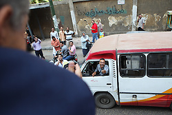 """A man surprised to see the bus shouts to Sabahi from his vehicle: """"I love you!"""" The driver added that he would be encouraging others to vote for him this week.."""