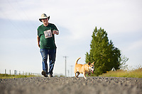 VALLEYFORD, WASHINGTON - Michael Robinson, 72, walks his regular mile route near his Valleyford, Wash. home Wednesday, May 21, 2014 with his dogs. Ever since being diagnosed with a cholesterol level of 233 in Dec. 2013, Robinson was put on a daily regimen of 20 mgs of Pravastatin, a healthy diet and exercise. Robinson now walks one mile five to six times per week near his home and his last cholesterol level was 188.
