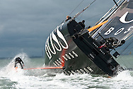 4th October 2011. Hugo Boss . .Pictures of Alex Thomson standing on the keel of his Open 60 racing yacht...