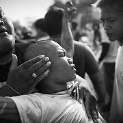 """A devotee in a trance is calmed by volunteers during the annual """"Wai Kru"""" tattoo festival at Wat Bang Pra in Nakhon Chasi, Thailand Saturday, March 23, 2013. Devotees attend the one day event to have their """"Sak Yant"""" religious tattoos energized by Buddhist monks and tattoo masters."""