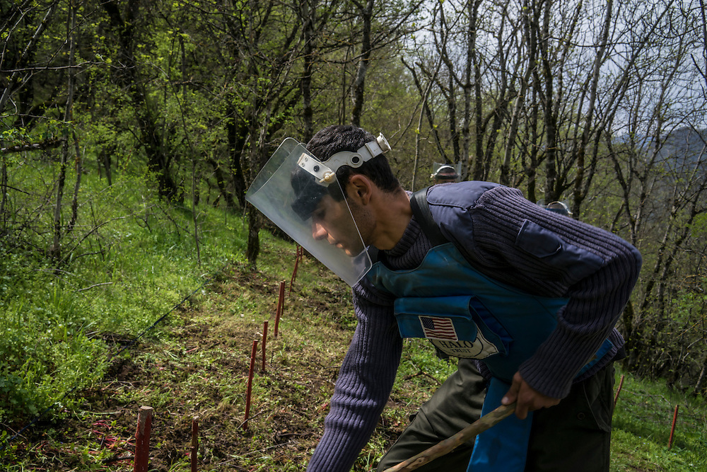 HAGOB KAMARI, NAGORNO-KARABAKH - APRIL 20: Ararat Arakelyan, a deminer with the charity HALO Trust, works to clear a minefield on April 20, 2015 in Hagob Kamari, Nagorno-Karabakh. Since signing a ceasefire in a war with Azerbaijan in 1994, Nagorno-Karabakh, officially part of Azerbaijan, has functioned as a self-declared independent republic and de facto part of Armenia, with hostilities along the line of contact between Nagorno-Karabakh and Azerbaijan occasionally flaring up and causing casualties. (Photo by Brendan Hoffman/Getty Images) *** Local Caption *** Ararat Arakelyan