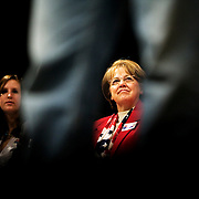 John Edwards supporters listen to John Edwards speak at a community meeting at Coe College during his campaign for the 2008 Democratic presidential nomination, Cedar Rapids, Iowa, November 19, 2007.
