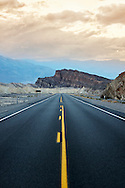 The center strip of a highway leading through Death Valley National Park, California.