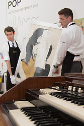 London, September 24th 2015. Gallery technicians move Andy Warhol's screenprint of Mick Jagger, part of a series of ten, the piece is expected to fetch up to £30,000 at auction. The artwork features in The Sotheby's Rock and Pop exhibition running 24th - 28th September ahead of an auction on the 29th. The exhibition gathers together lyrics, instruments, stage costumes and artworks from some of the world's greatest pop and rock performers and groups, including Abba, The Beatles, Bob Dylan, Pink Floyd and Bruce Springsteen.