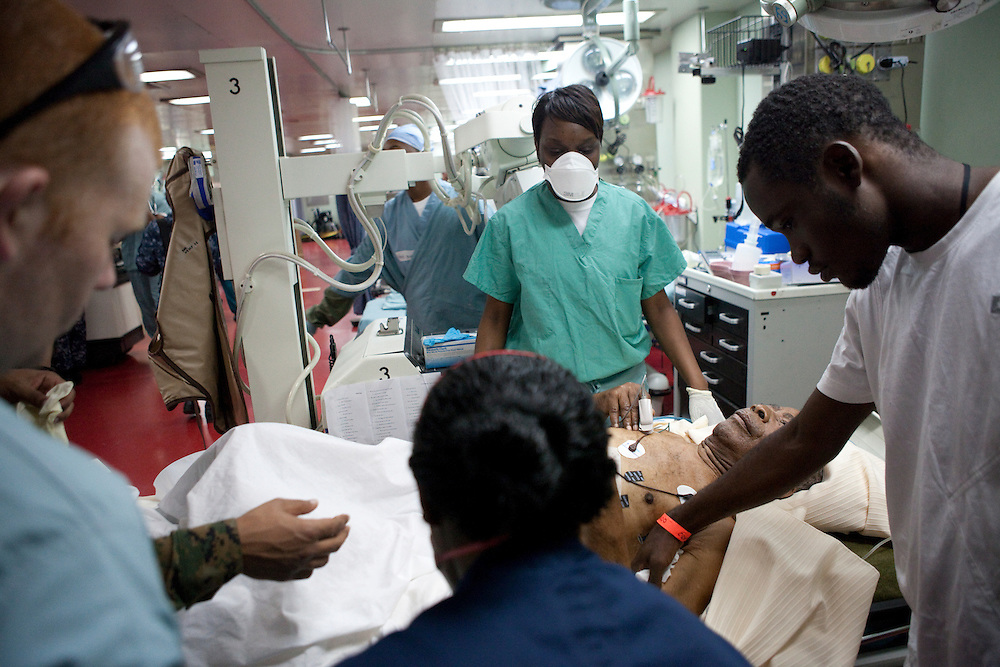 A Haitian man receives treatment in the casualty reception area on board the USNS Comfort, a naval hospital ship, on Wednesday, January 20, 2010 in Port-Au-Prince, Haiti. The Comfort deployed from Baltimore, bringing nearly a thousand medical personnel to care for victims of Haiti's recent earthquake.