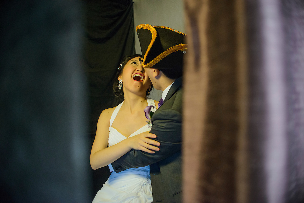Photo by Matt Roth.Assignment ID: 30140754A..Evelyn Hsieh and Michael Wong ham it up in the photo booth at their reception at the the Mount Vernon Inn, in Mount Vernon, Virginia on Saturday, April 06, 2013.