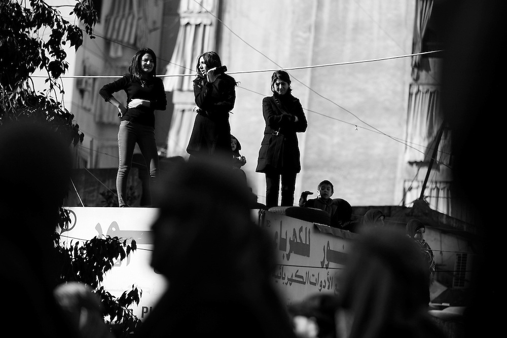 Residents of Dahiyeh took to the rooftops to watch the religious rally pass by.
