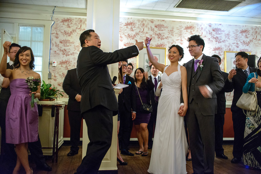 """Photo by Matt Roth.Assignment ID: 30140754A..Father of the bride Paul Hsieh raises an """"invisible glass"""" to toast the new bride and groom during Evelyn Hsieh and Michael Wong's reception at the the Mount Vernon Inn, in Mount Vernon, Virginia on Saturday, April 06, 2013."""