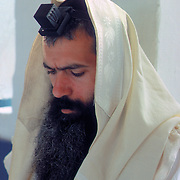 Religious Jewish man at morning prayers, Israel.