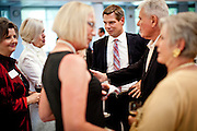 Democratic congressional challenger Eric Swalwell mingles at a community fundraising event in San Ramon, Calif., September 21, 2012.
