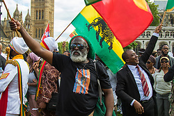 Paliament Square, Westminster, London, August 1st 2015. Thousands of black Londoners, Rastafarians and their supporters arrive at Parliament Square following a march from Brixton, as part of the Rastafari Movement UK Emancipation Day, to demand reparations from the British government for the slave trade.