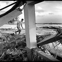 USE ARROWS &larr; &rarr; on your keyboard to navigate this slide-show<br /> <br /> Car Nicobar , Andaman and Nicobar Islands, India 12 January 2005<br /> Devastation in the coastal line of Car Nicobar island, south of Andaman Islands. <br /> Officials reported around 300,000 people died after a tsunami, in the countries around Indian Ocean. Thousands of people have been displaced following the devastation causing a humanitarian crisis.<br /> Photo: Ezequiel Scagnetti