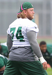May 24, 2012; Florham Park, NJ, USA; New York Jets center Nick Mangold (74) stretches during the New York Jets OTA at their training facility.