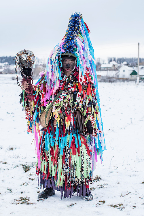 Mykola Mytryk, 21, in the costume of a gypsy, poses for a portrait during celebrations of the Malanka Festival on Thursday, January 14, 2016 in Krasnoilsk, Ukraine. The annual celebrations, which consist of costumed villagers going in a group from house to house singing, playing music, and performing skits, began the previous sundown, went all night, and will last until evening.