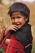 Quechua Indian girl in a hamlet of Ayata, Departamento La Paz, Provincia Munecas, in the Andes of Bolivia.