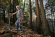 Washington, CT- E. Terry Clark enjoys searching for buried treasures, which he says has become a lost art, in the special places near his home in Washington, CT. Among his finds are small gems, arrowheads, bottles and other assorted finds. (Photo by Robert Falcetti)