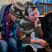 15 of April 2015 / Petrovski/ Donetsk Oblast/ Ukraine - Czech photographer Iva Zimova trying to comfort Babushka as she often cry, lost hope for a better life sometimes. This was the second day we visited the bunkers.