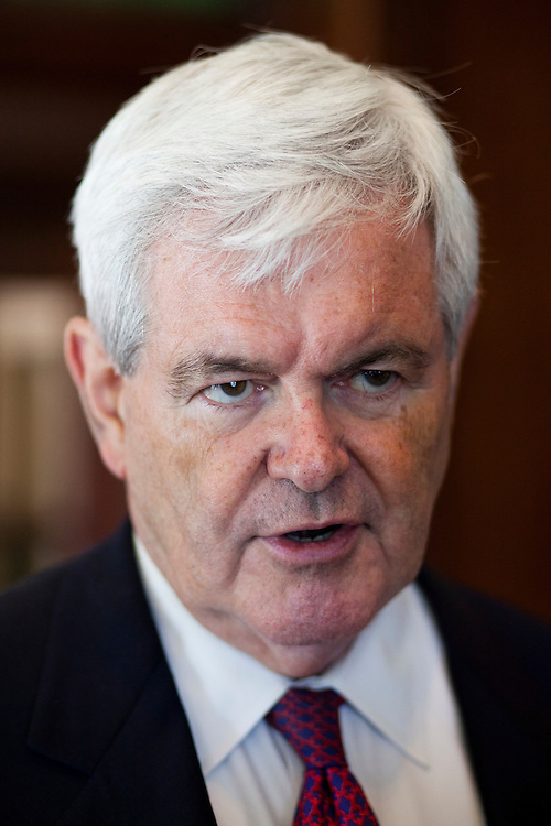 Republican presidential hopeful Newt Gingrich talks with reporters after a campaign stop at the Cedar Rapids Country Club on Thursday, August 4, 2011 in Cedar Rapids, IA.