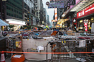 Barricades set up on one of Hong Kong's busiest roads. Protesters known as the Umbrella Revolution or Occupy Mongkok, an extension of the larger Occupy Central movement, have taken over a number of blocks on the busy road and staged an ongoing demonstration calling for universal suffrage for Hong Kong.