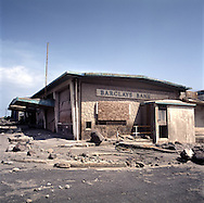 The former capital of Montserrat, Plymouth, which is now covered under a layer of ash, mud and rock from the eruption of the Soufriere Hills volcano over the last 10 years. The area is out of bounds to everyone except scientists. Photo shows destroyed Barclays Bank..Photo©Steve Forrest/Workers Photos