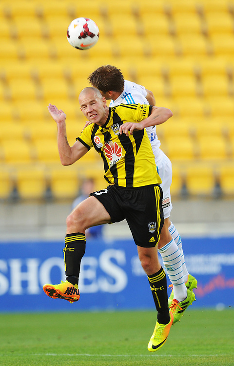 Phoenix's Stein Huysegems heads the ball in front of Melbourne Victory's Adrian Leijer in the A-League football match at Westpac Stadium, Wellington, New Zealand, Saturday, Januray 18, 2014. Credit:SNPA / Ross Setford