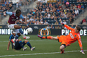 Zac MacMath of the Philadelphia Union blocks Nathan Delfouneso of Aston Villa's shot during a match between Aston Villa FC and Philadelphia Union at PPL Park in Chester, Pennsylvania, USA on Wednesday July 18, 2012. (photo - Mat Boyle)