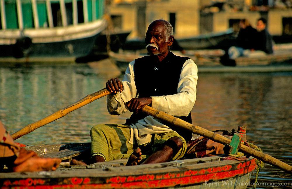 Asia, India, Varanasi. A man rows quietly on the Ganges River at Varanasi.